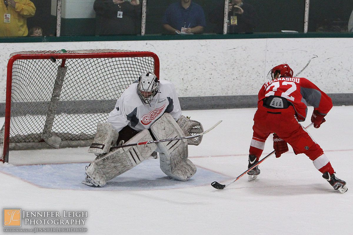 Andreas Athanasiou attempts a penalty shot on Andrew D'Agostini