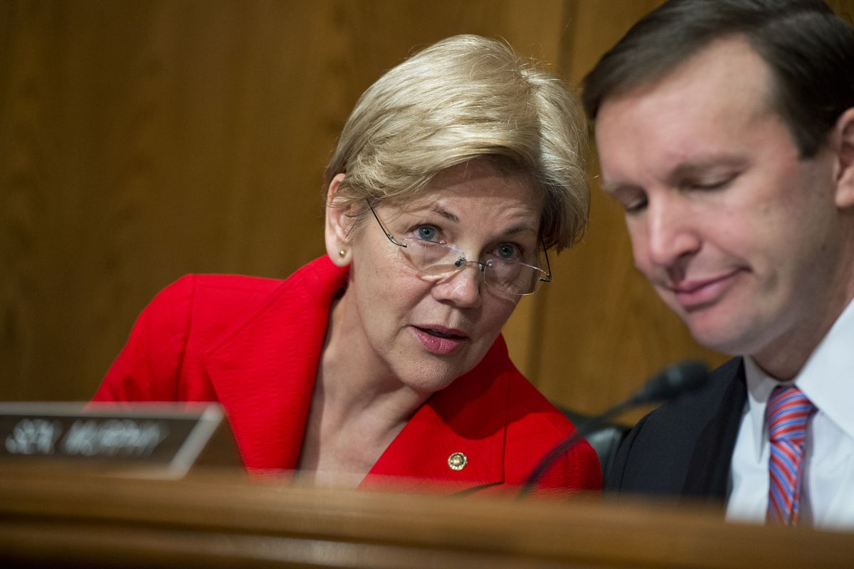 Sens. Elizabeth Warren and Chris Murphy attend a Senate hearing in 2016 on the implementation of the Every Student Succeeds Act with Education Secretary John King.