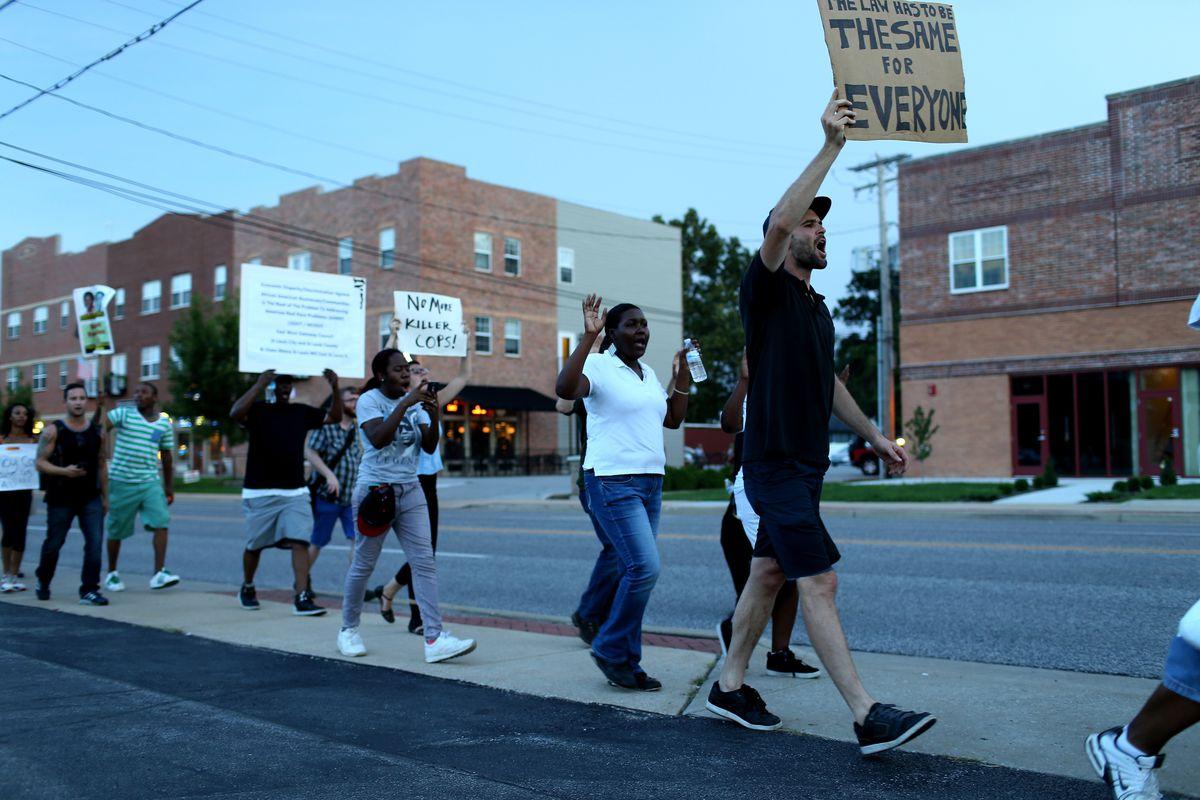 Demonstrators march in Ferguson, Missouri.