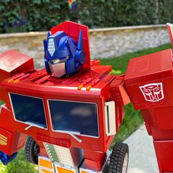 You can remove the red flap, it just pops off, but it serves to cover the top of the cab once the head is inside.