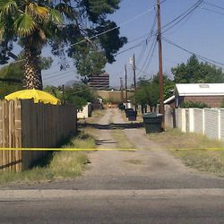 An alley path behind the street where a 6-year-old Tucson girl went missing from her home is cut off with police tape in Tucson, Ariz., Sunday, April 22, 2012. Police cordoned off a neighborhood block where Isabel Mercedes Celis went missing from her home during the night, as authorities fanned out Sunday over a wide area looking for clues to the possible kidnapping.