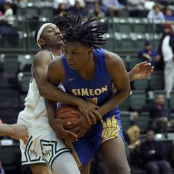 Simeon's Sincere Callwood (4) is harassed by Morgan Park's Christian Roberts (3) in their CPS semi final game at Chicago State University, Friday, February 15, 2019. | Kevin Tanaka/For the Sun Times