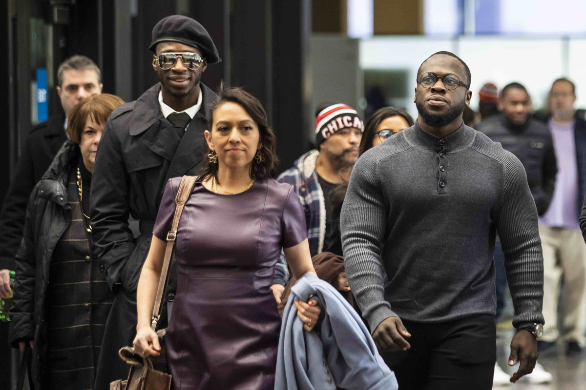 The Osudairo brothers and their attorney, Gloria Schmidt, enter the Leighton Criminal Courthouse Monday morning. Both men are expected to be key witnesses in the case against Jussie Smollett, who appeared Monday as well.