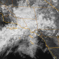 This satellite image provided by NOAA shows the California coastline with a plume of moisture from former Tropical Storm John bringing showers to Southern California on Wednesday, Sept. 5, 2012, including the area where a wildfire has been burning in the San Gabriel Mountains since the weekend. More than 1,200 firefighters were working to increase containment of the blaze northeast of Los Angeles. The National Weather Service said the chance of showers and thunderstorms would last through Thursday.