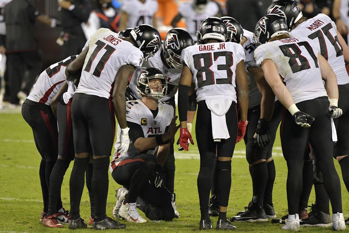Matt Ryan #2 of the Atlanta Falcons huddles the offense against the Carolina Panthers during the fourth quarter at Bank of America Stadium on October 29, 2020 in Charlotte, North Carolina.