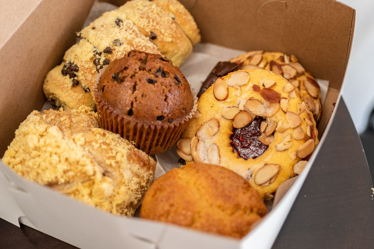 A side view of tan-colored pastries and baked goods at an aging bakery.