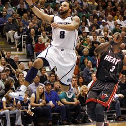 Jazz guard Deron Williams drives past Miami Heat guard Dwayne Wade in Salt Lake City.