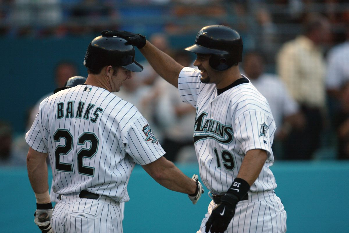 Mike Lowell high fives Brian Banks