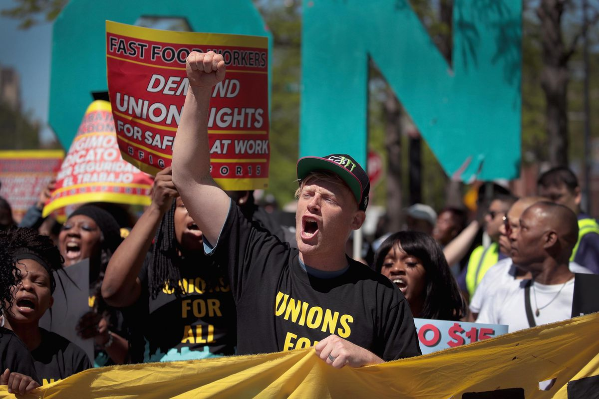 Demonstrators, who were joined by Democratic presidential candidate and Washington governor Jay Inslee, march to McDonald's corporate headquarters to demand $15-per-hour wages for fast food workers on May 23, 2019 in Chicago, Illinois. Inslee is one of mo