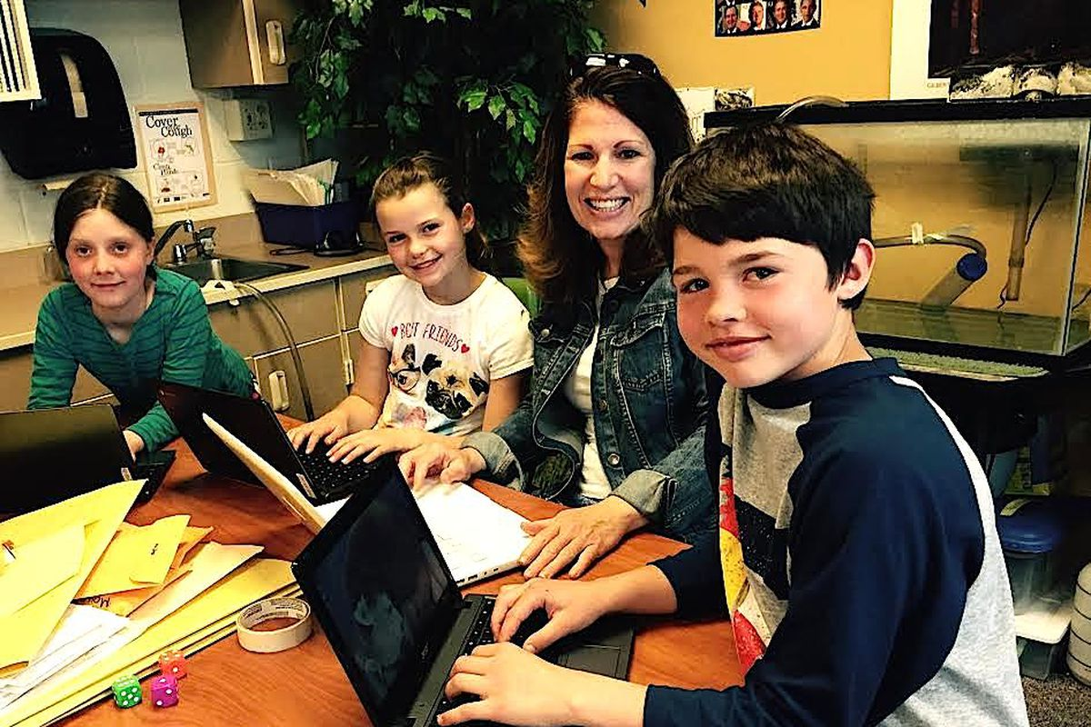 Cynthia Rimmer, a fourth grade teacher at Fraser Valley Elementary School in the East Grand School District, works with students.