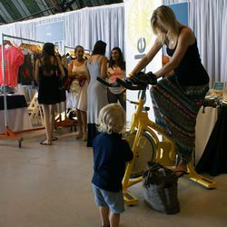 As if all the intense retail therapy wasn't burning enough calories, some shoppers opted for a pedaling break at SoulCycle's booth.