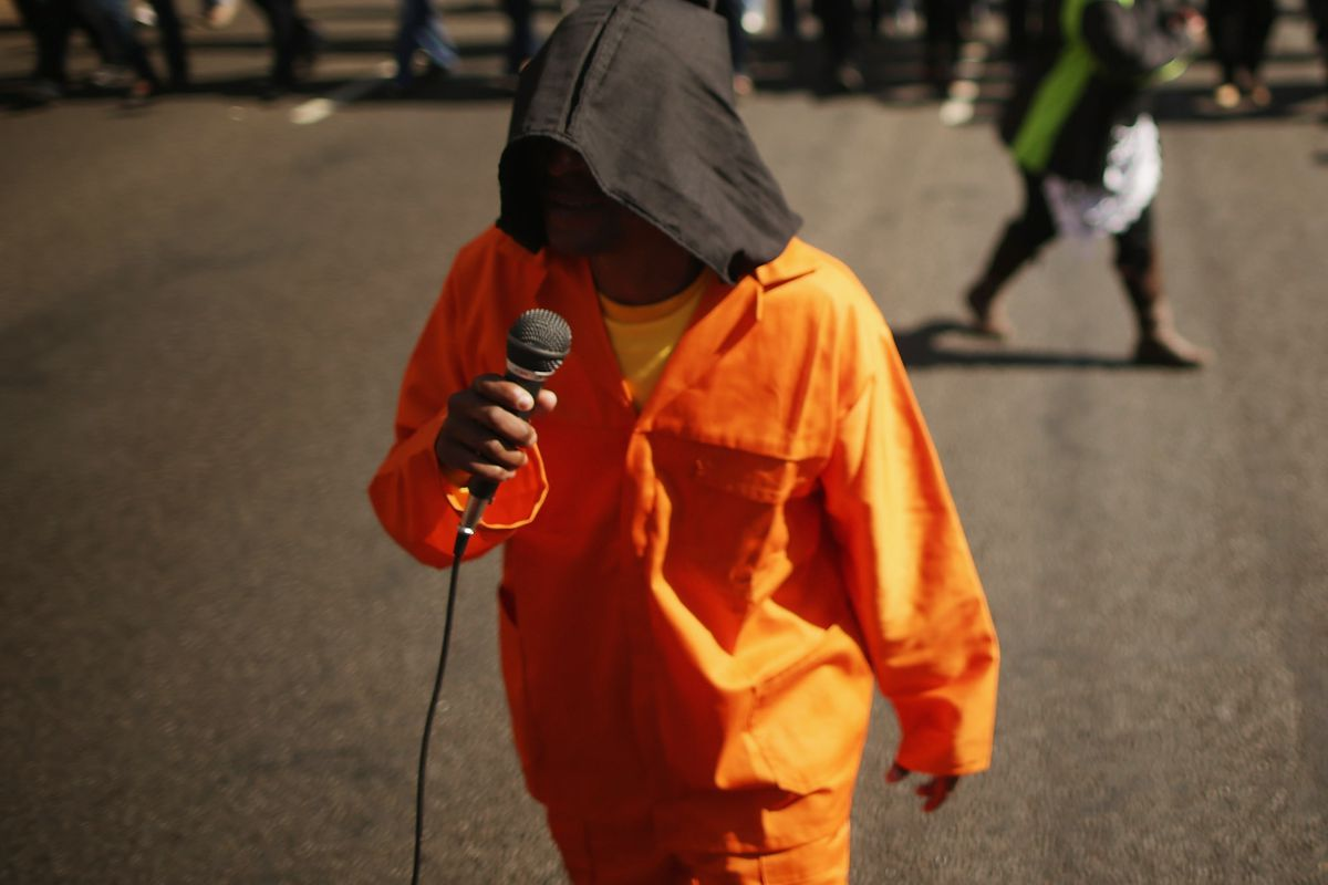 A demonstration in South Africa with protestors dressed up as Guantanamo inmates.
