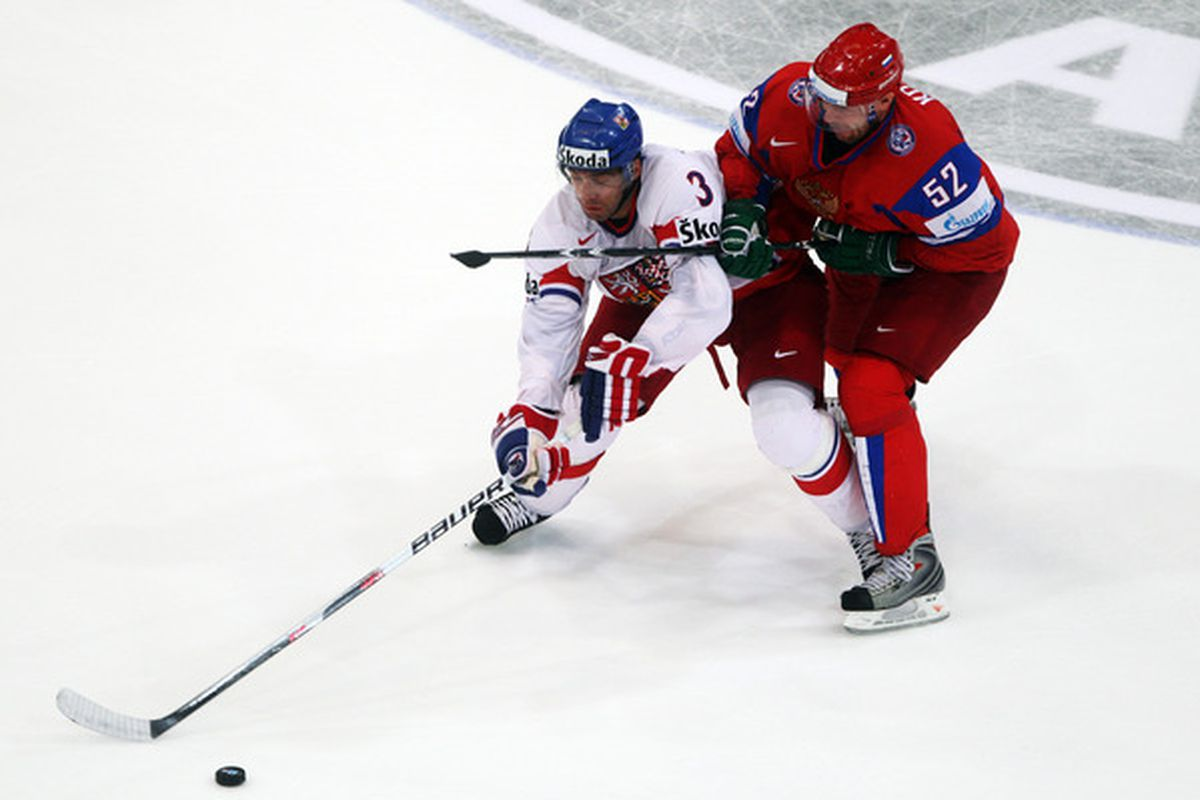 That's Viktor Kozlov wearing #52, representing Russia and trying to hook Michal Rozsival.  He disappointed me as a Devil.