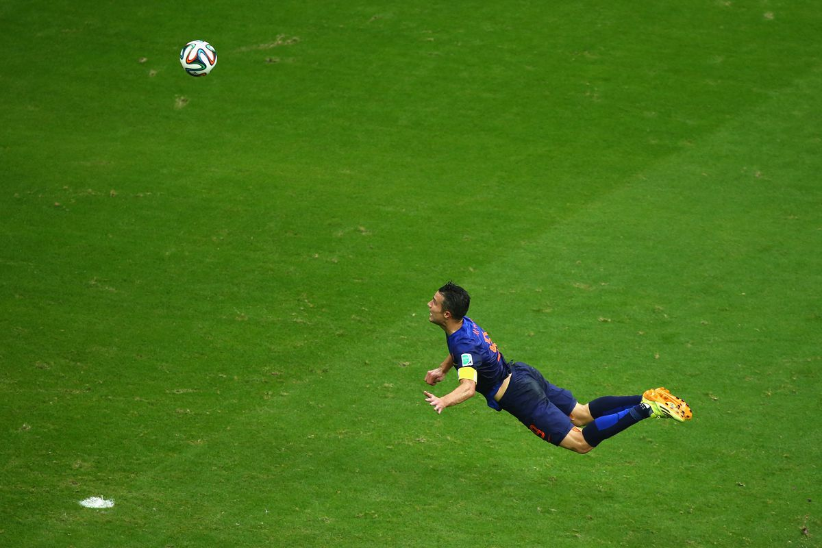 Robin van Persie soars through the air to score the Dutch equalizer