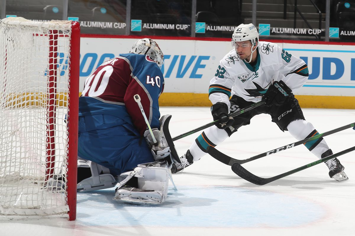 Goaltender Devan Dubnyk #40 of the Colorado Avalanche makes a save against Kevin Labanc #62 of the San Jose Sharks at Ball Arena on May 01, 2021 in Denver, Colorado.