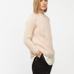 """<a href=""""http://needsupply.com/the-karren.html"""">The Karen sweater by Babe</a>, $222.59 (was $425)"""