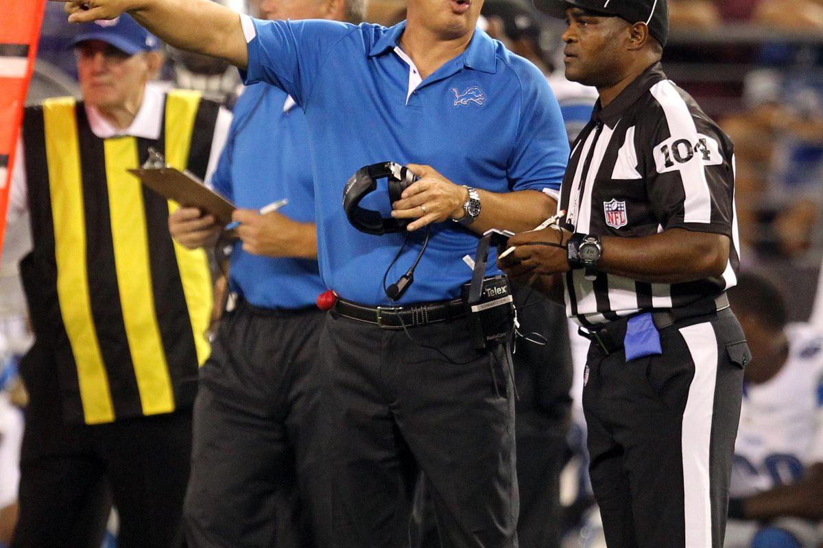 August 17, 2012; Baltimore, MD, USA; Detroit Lions head coach Jim Schwartz talks with line judge Derrick Smith (104) during their preseason game against the Baltimore Ravens at M&T Bank Stadium. Mandatory Credit: Mitch Stringer-US PRESSWIRE