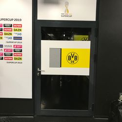 The door to the BVB locker room at the side of the mixed zone. August 2, 2019.