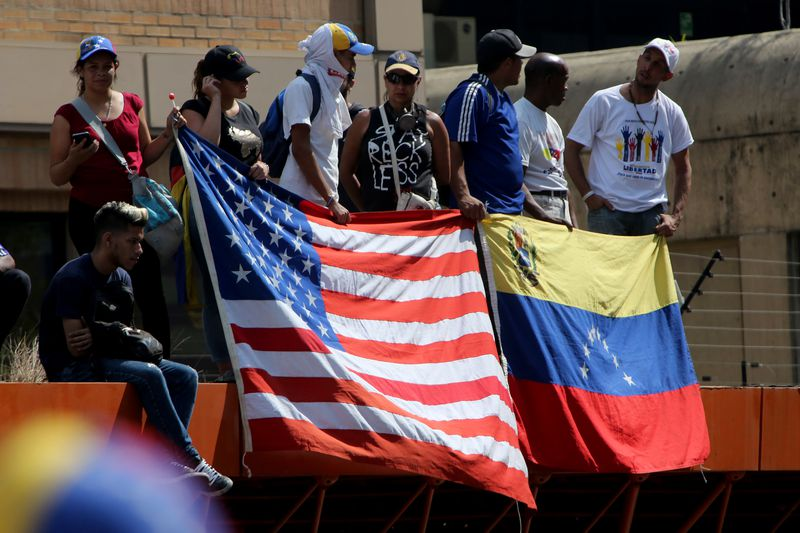 Supporters of Juan Guaidó show flags of United States and Venezuela during a May 1, 2019 demonstration in Caracas, Venezuela.