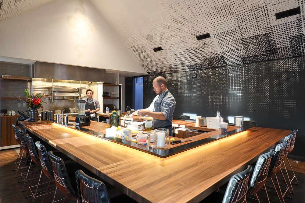 Chef Duncan Holmes behind Beckon's three-sided chef's counter