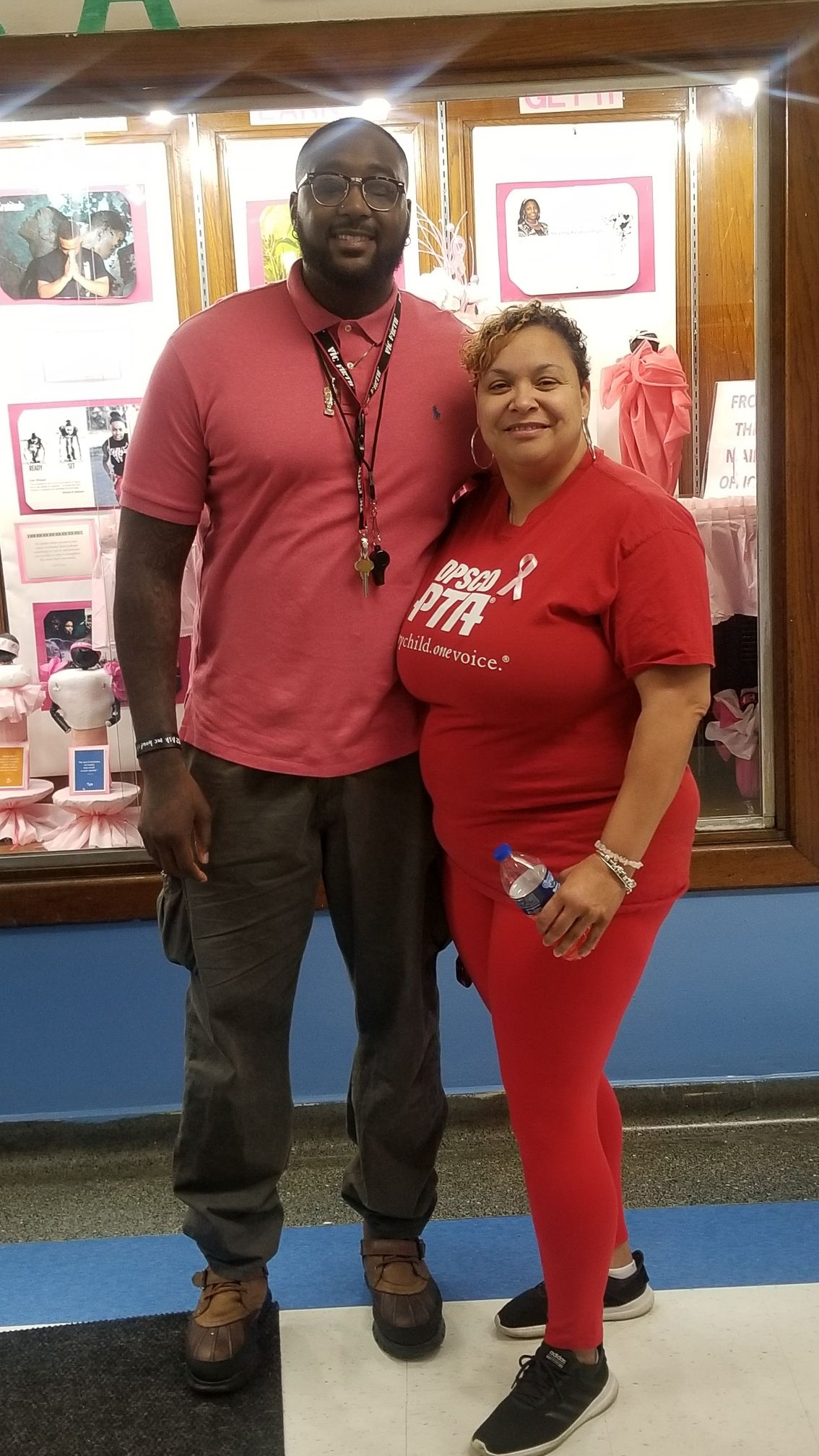 Thomas Fields, the school culture facilitator at Paul Robeson Malcolm X Academy, is shown with Melissa Redman, the school's parent action leader. Fields died March 30 from coronavirus complications.