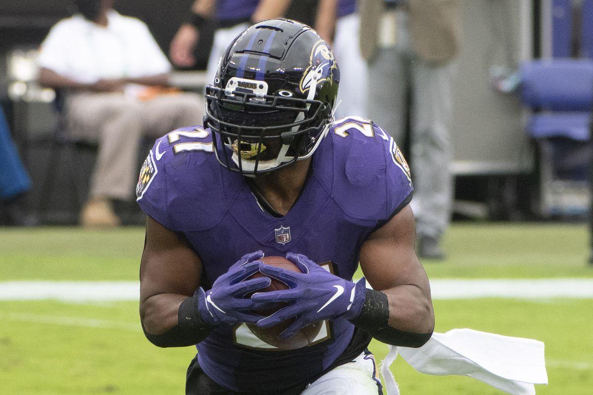 Baltimore Ravens running back Mark Ingram (21) rushes during the first quarter against the Cincinnati Bengals at M&T Bank Stadium.