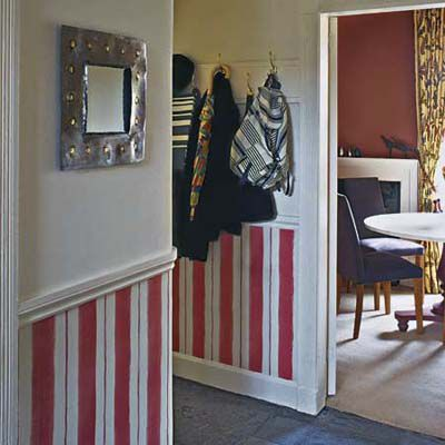 Red stripes painted onto white wainscoting.