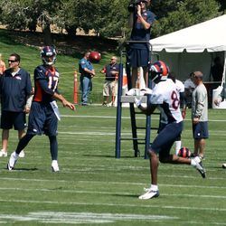 Brock Osweiler completes a pass to Julius Thomas during training camp's second day