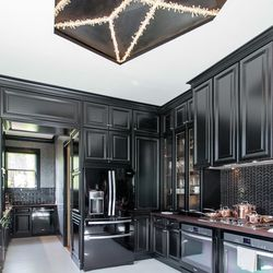 Incredible kitchen by by Steven Miller Design Studio, with a custom light fixture by Christopher Boots.