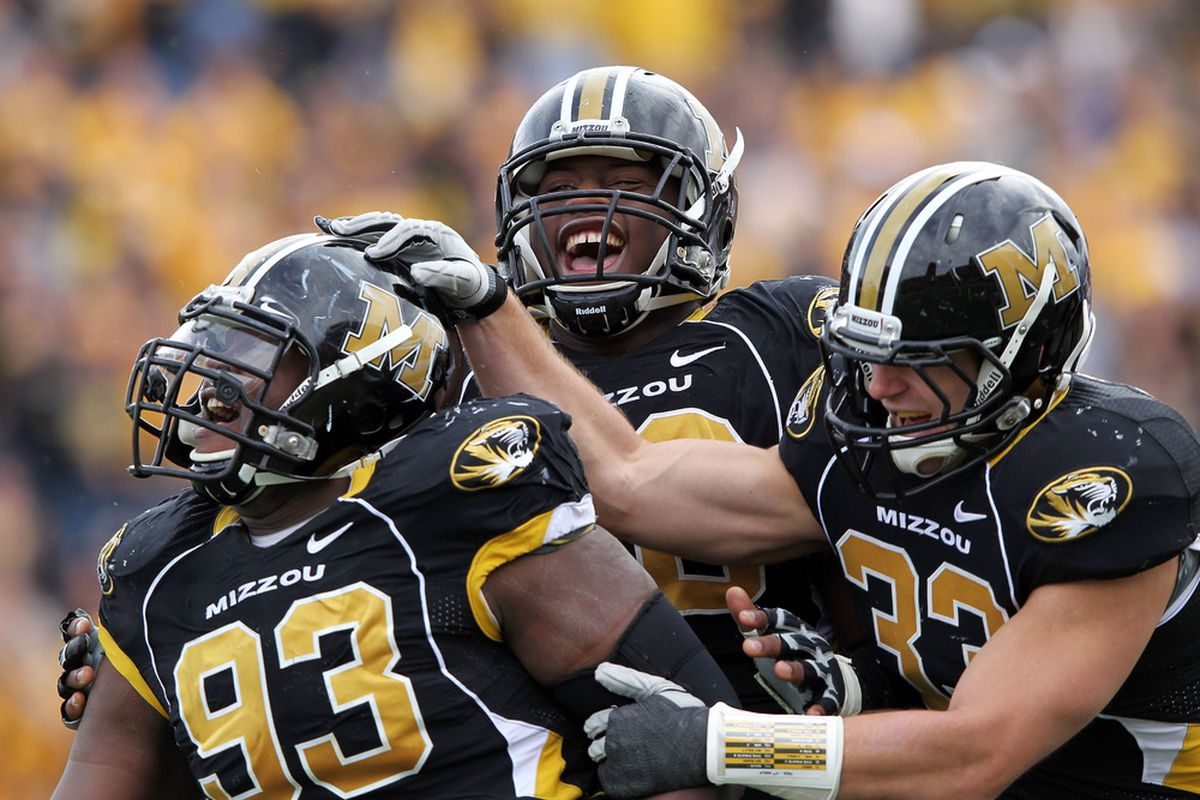 Terrell Resonno #93 of the Missouri Tigers is congratulated by teammates after sacking quarterback David Ash #14 of the Texas Longhorns during the game on November 12, 2011.