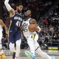 Utah Jazz guard Donovan Mitchell (45) moves around New Orleans Pelicans' Garrett Temple during a preseason NBA game at the Vivint Smart Home Arena in Salt Lake City on Monday, Oct. 11, 2021.