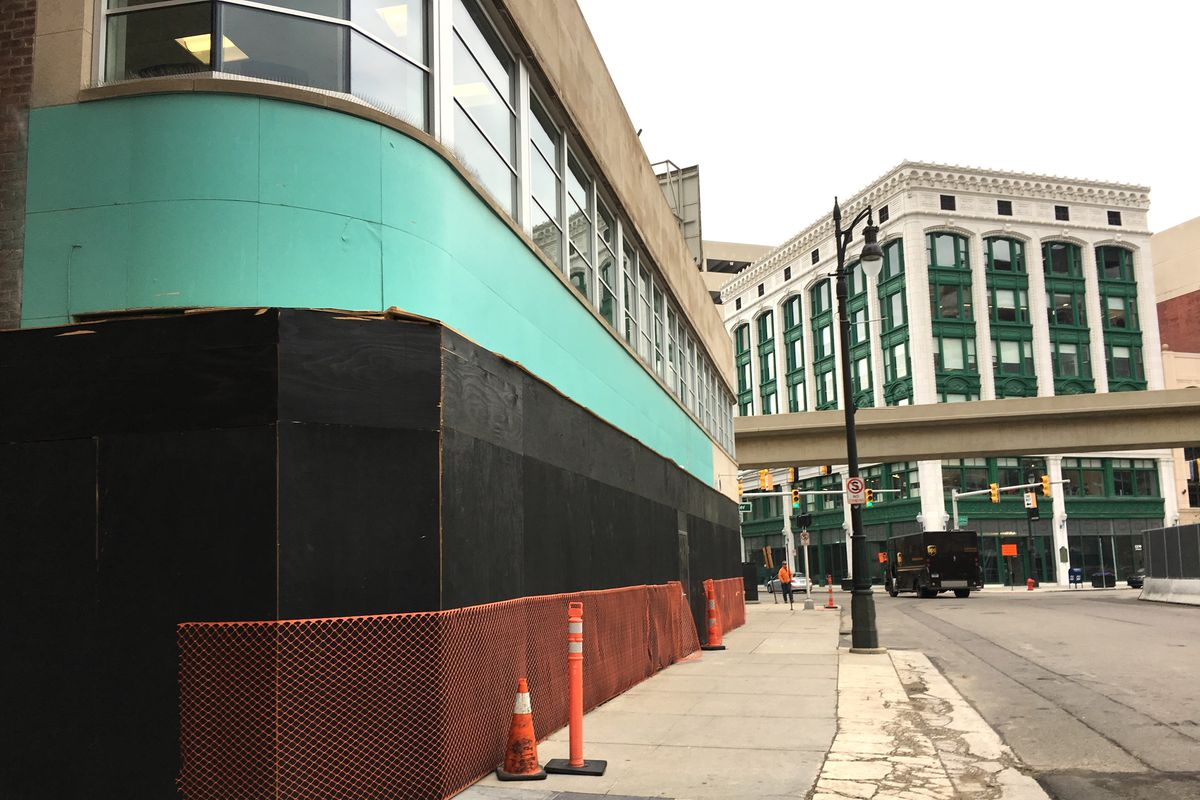 The black and green boarded up exterior of the PuppetArt Theatre building in downtown Detroit in May 2019.