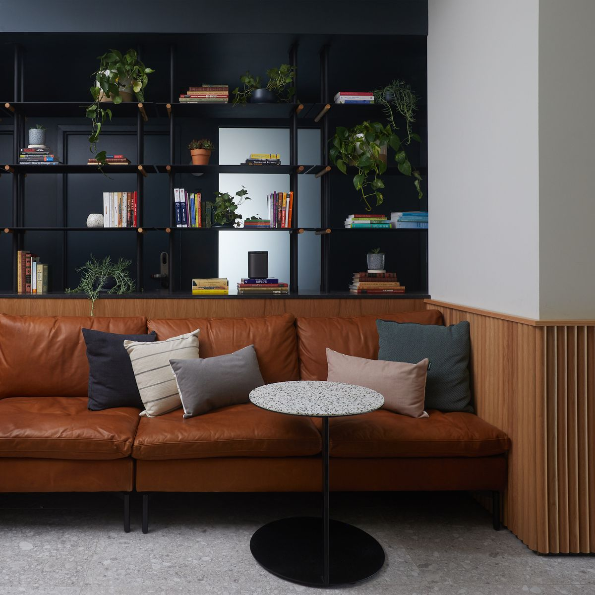 Leather couch with table in front of it
