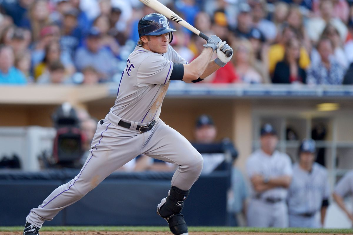 San Diego, CA, USA; Colorado Rockies shortstop Josh Rutledge (14) hits an RBI single during the fourth inning against the San Diego Padres at PETCO Park. Mandatory Credit: Jake Roth-US PRESSWIRE