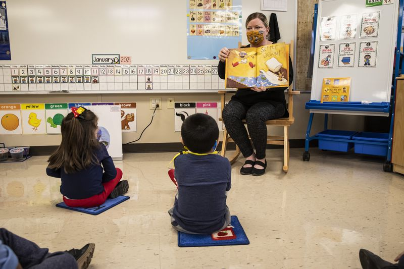 Preschool teacher Angela Panush reads a story to her students at Dawes Elementary School at 3810 W. 81st Pl. on the Southwest Side, Monday morning, Jan. 11, 2021.