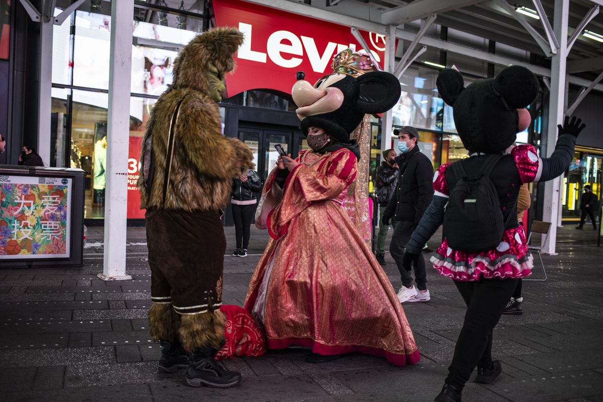 José (left) and Nadia are street performers in Times Square, vying with dozens — sometimes hundreds — of others for the attention of tourists, who snap pictures with them for tips.