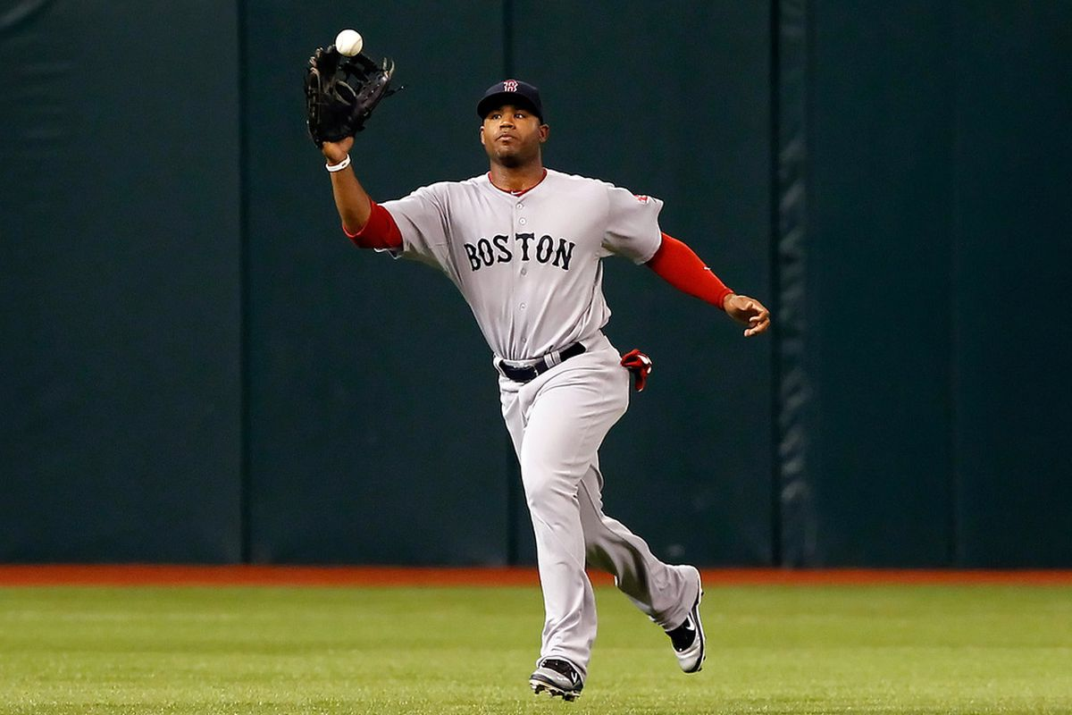 ST. PETERSBURG, FL - JUNE 14:  Outfielder Carl Crawford #13 of the Boston Red Sox catches a fly ball against the Tampa Bay Rays during the game at Tropicana Field on June 14, 2011 in St. Petersburg, Florida.  (Photo by J. Meric/Getty Images)