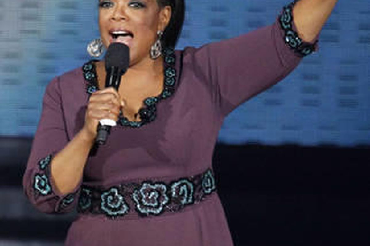 """FILE - In this May 17, 2011 file photo, Oprah Winfrey acknowledges fans during a star-studded double-taping of """"Surprise Oprah! A Farewell Spectacular,"""" in Chicago."""