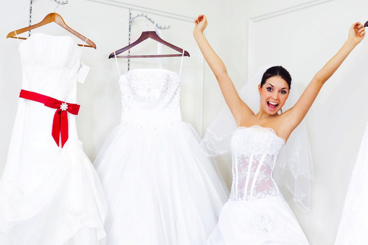 """Image via <a href=""""http://www.shutterstock.com/pic-45092137/stock-photo-pretty-young-excited-woman-is-choosing-a-wedding-dress-in-the-shop.html?src=799ECD3C-97C6-11E2-B676-4BD4ACE6966E-1-7"""">Lana K</a>/Shutterstock"""