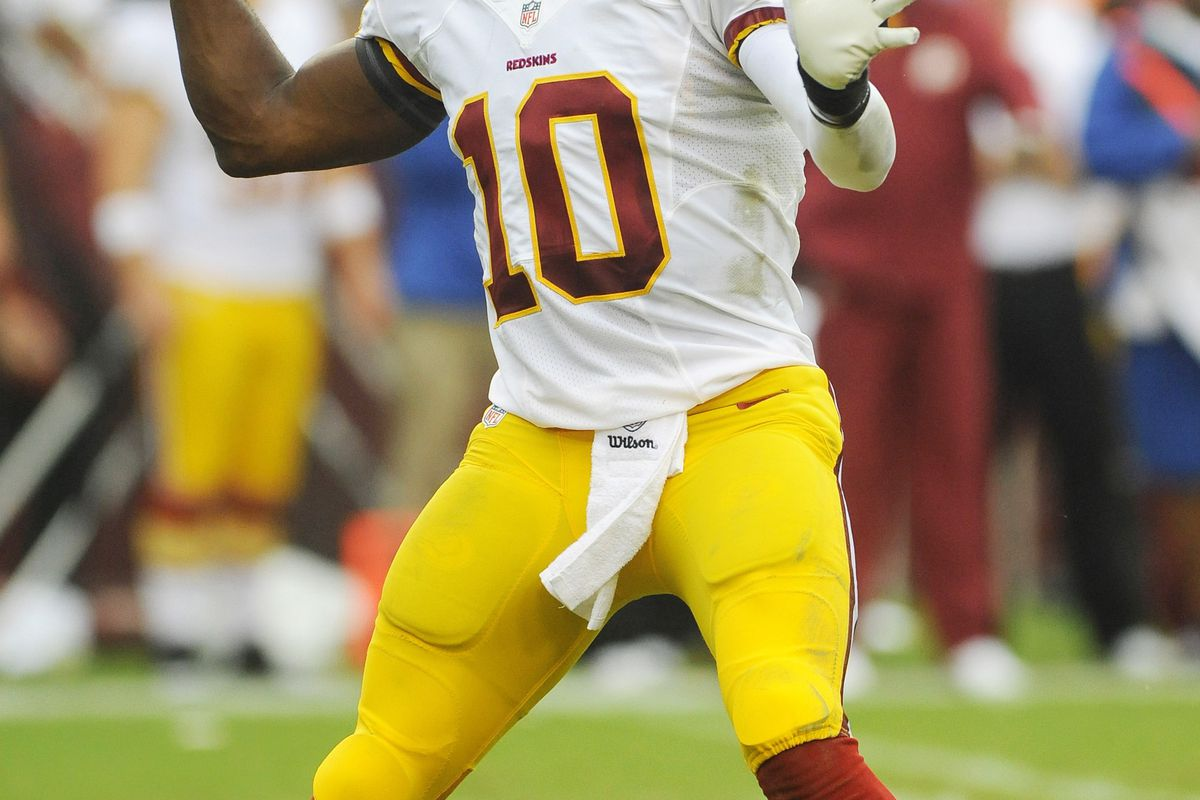 Aug 25, 2012; Landover, MD, USA; Washington Redskins quarterback Robert Griffin III (10) drops back to pass during the first half against the Indianapolis Colts at FedEX Field. Mandatory Credit: Brad Mills-US PRESSWIRE