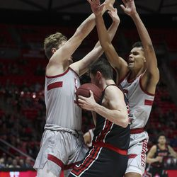 Utah Utes forward Riley Battin (21) drives on Stanford Cardinal forward James Keefe (22) in Salt Lake City, Thursday, Feb. 6, 2020.