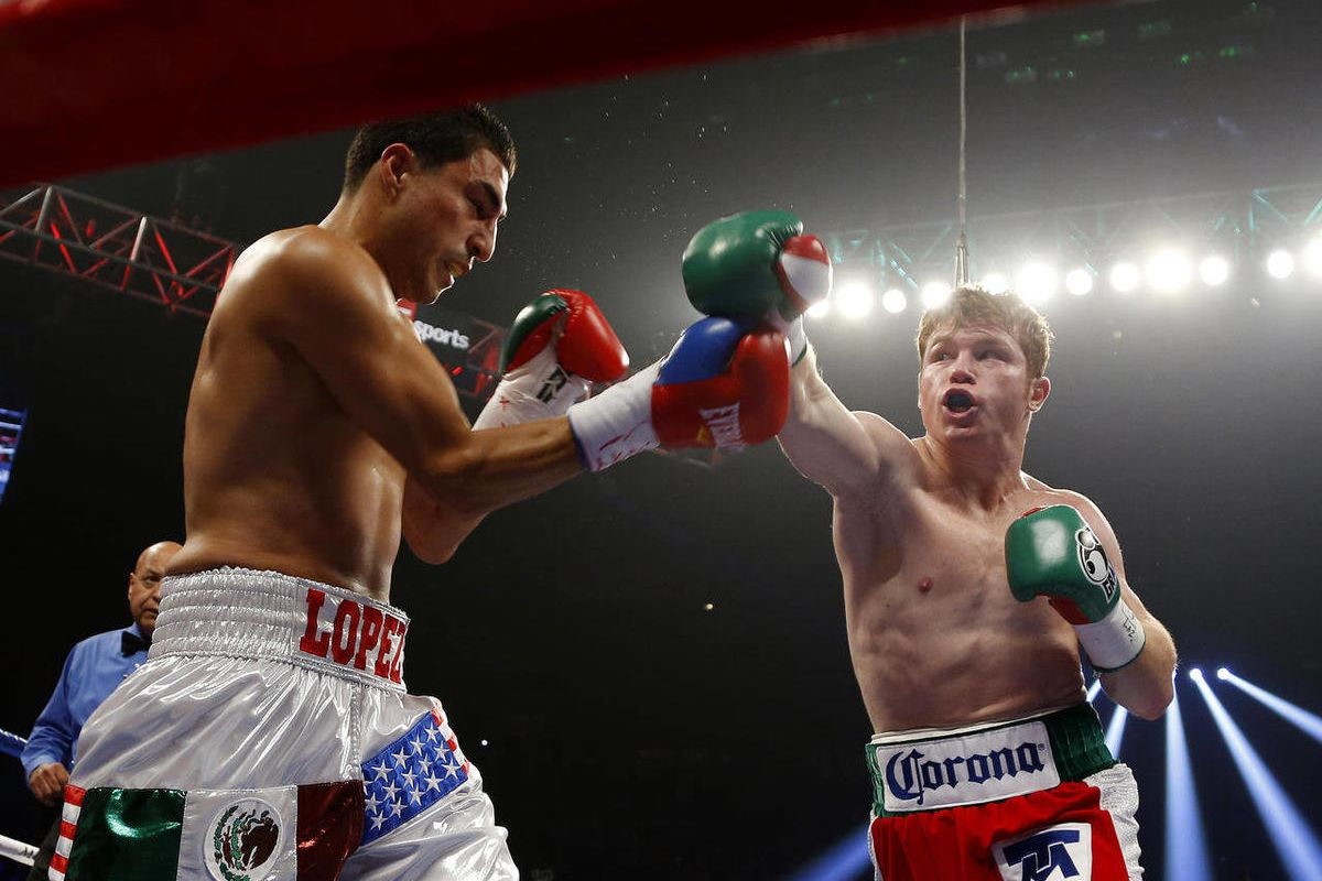 Canelo Alvarez, right, of Mexico, punches Josesito Lopez during a WBC super welterweight championship boxing match on Saturday, Sept. 15, 2012, in Las Vegas.