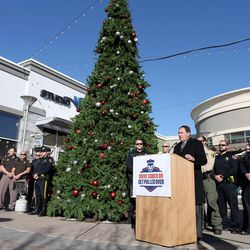 Gov. Gary Herbert launches a new Holiday DUI-prevention effort between the Utah Highway Safety Office, Utah Highway Patrol, local law enforcement, the Utah Department of Alcoholic Beverage Control and singer songwriters (David Osmond and Carmen Rasmusen Herbert) at Fashion Place Mall in Murray on Friday, Dec. 18, 2015.