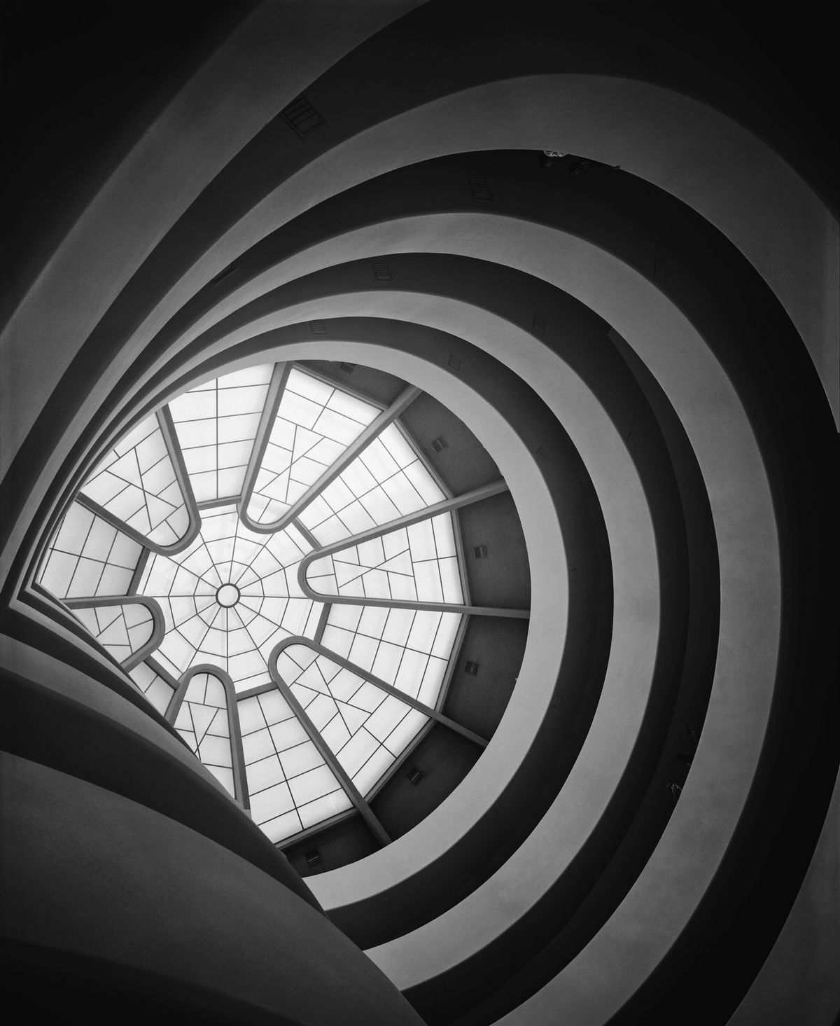 An image of the Guggenheim's spiral atrium looking upward to a skylight.