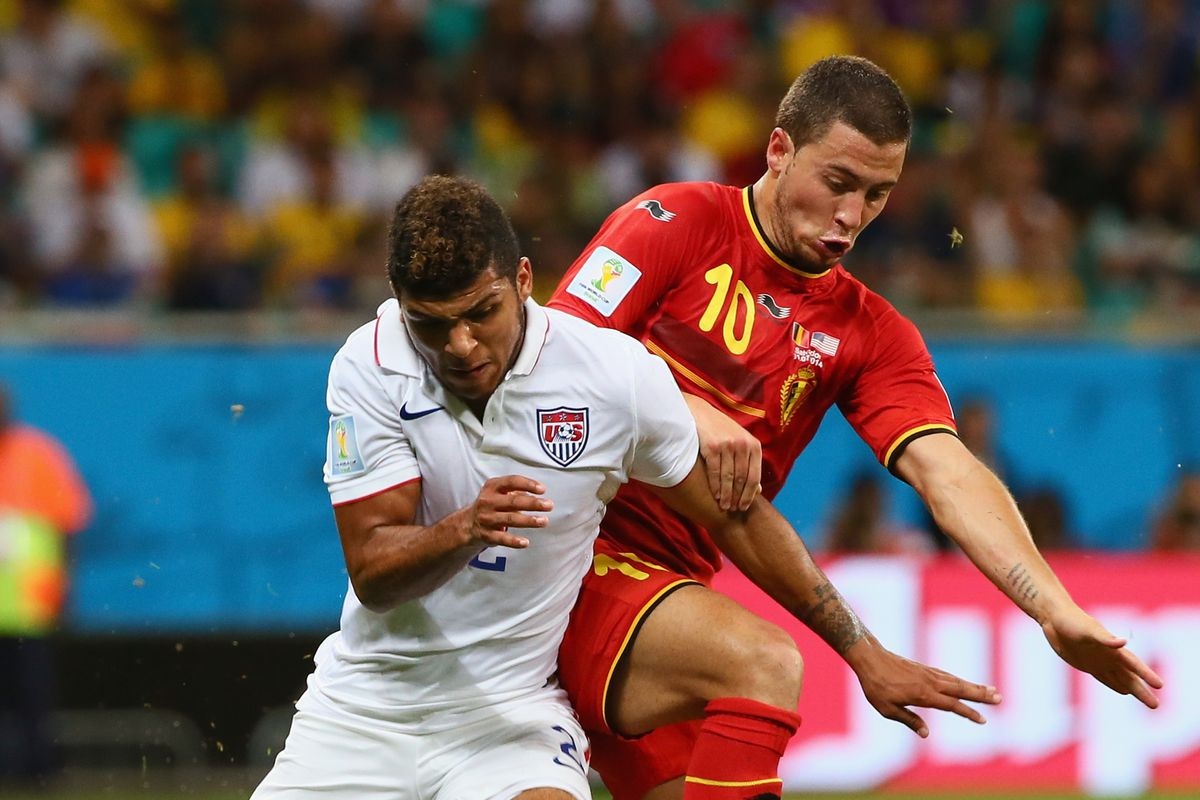 DeAndre Yedlin fights off a challenge during the USA's 2-1 loss to Belgium.