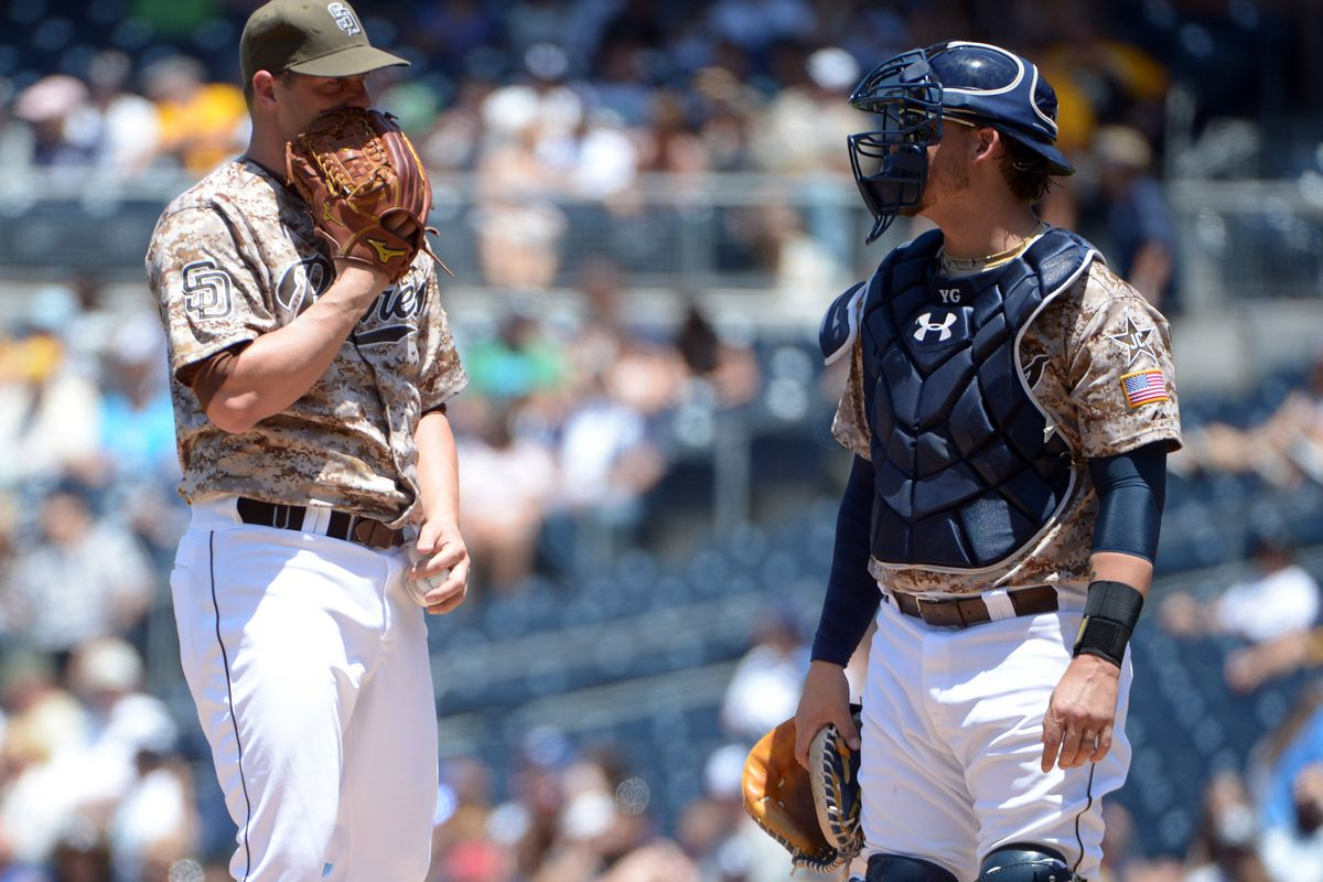 Eric Stults hides his face in shame.