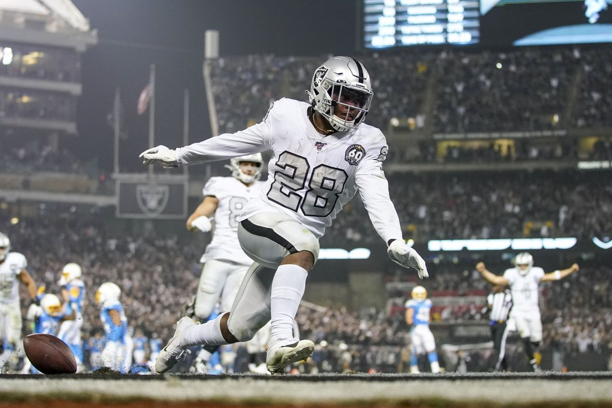Oakland Raiders running back Josh Jacobs scores the game-winning touchdown against the Los Angeles Chargers during the fourth quarter at Oakland Coliseum.