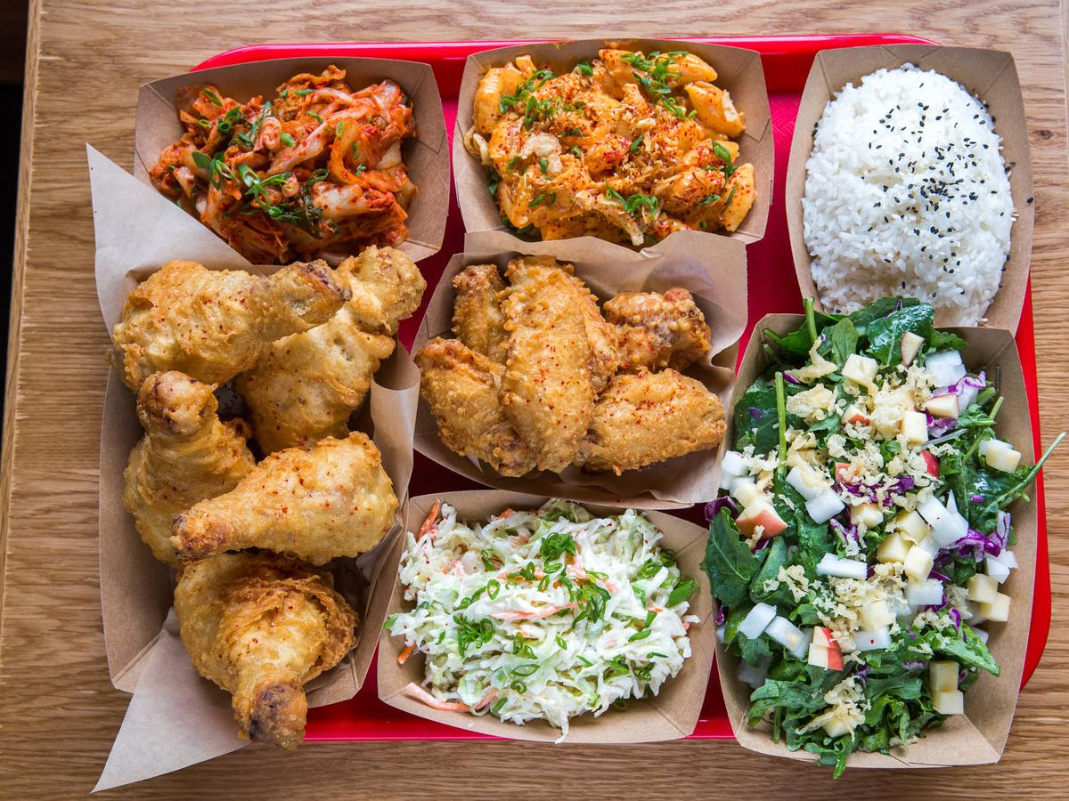 A top-down view of a Bok a Bok platter, with fried chicken, coleslaw, and an array of other sides.