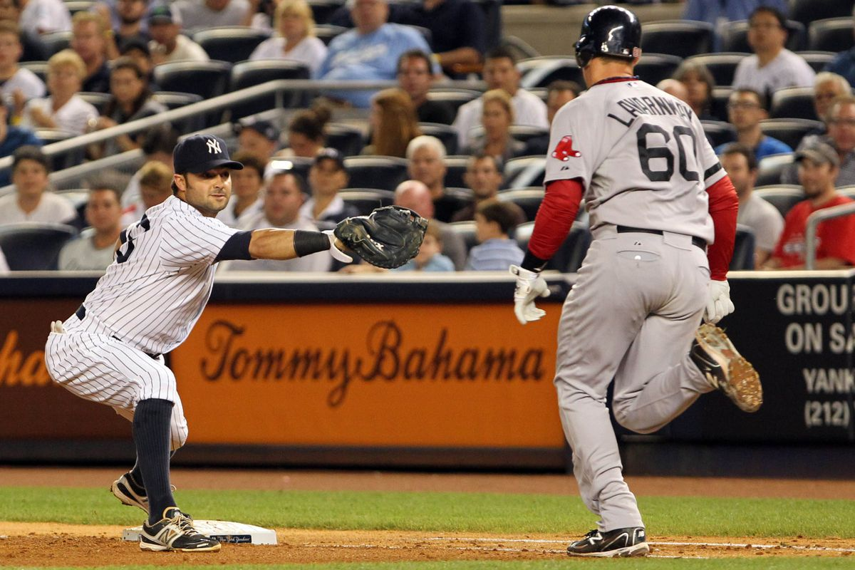 Aug 19, 2012; Bronx, NY, USA;  New York Yankees first baseman Nick Swisher (33) forces out Boston Red Sox catcher Ryan Lavarnway (60) during the fifth inning at Yankee Stadium. Mandatory Credit: Anthony Gruppuso-US PRESSWIRE