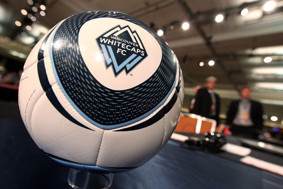 BALTIMORE - JANUARY 13: A view of the jerseys of the Vancouver Whitecaps logo and table during the 2011 MLS SuperDraft on January 13 2011 at the Baltimore Convention Center in Baltimore Maryland. (Photo by Ned Dishman/Getty Images)